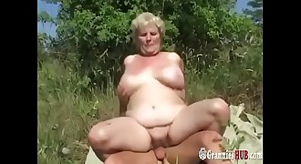 Chubby Granny Blonde With Thick Tits And Her Young Paramour Fuck Outdoor