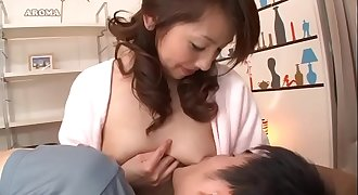 Japanese mom breastfeeds young man while she jerks him of